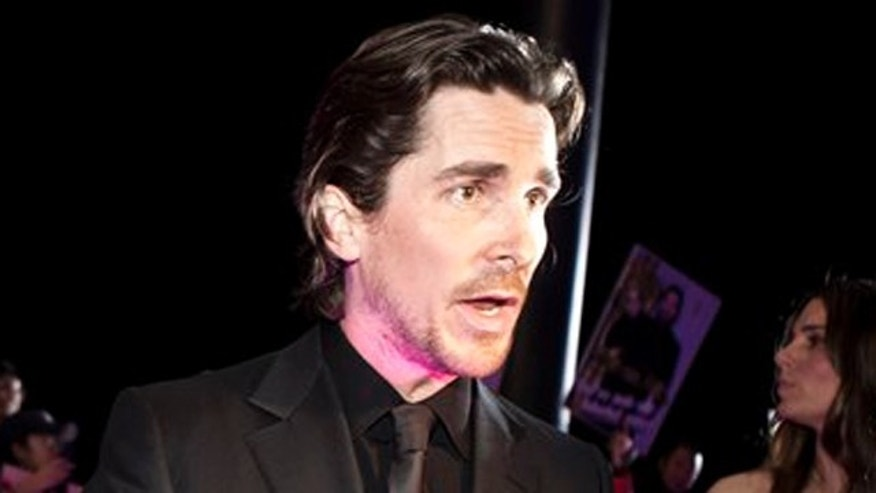 "December 12, 2011: English actor Christian Bale speaks to journalists during an interview on the red carpet as he arrives for an event of the Zhang Yimou-directed new movie ""The Flowers of War"" in Beijing, China."
