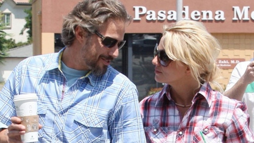 June 25: Britney Spears and boyfriend Jason Trawick head out for a romatic weekend in Palm Springs, CA.
