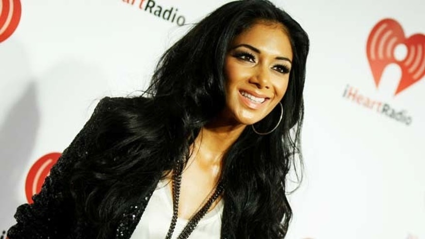 Sept. 24, 2011:  Singer Nicole Scherzinger poses in the press room at the iHeartRadio Music Festival held at the MGM Grand Garden Arena in Las Vegas, Nev.