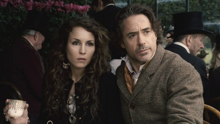 "In this film image released by Warner Bros. Pictures, Noomi Rapace, left, and Robert Downey Jr. are shown in a scene from ""Sherlock Holmes: A Game of Shadows."""