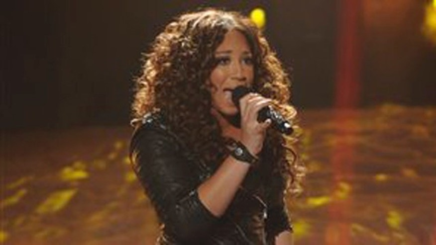 """In this Nov. 30, 2011 file photo released by FOX, Melanie Amaro performs on the singing competition series, """"The X Factor,"""" in Los Angeles, where contestants sang songs by Michael Jackson for a tribute to the late King of Pop."""