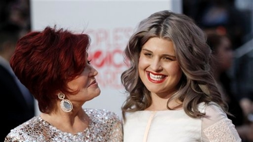 Sharon Osbourne, left, and Kelly Osbourne arrive at the People's Choice Awards on Wednesday, Jan. 11, 2012 in Los Angeles.