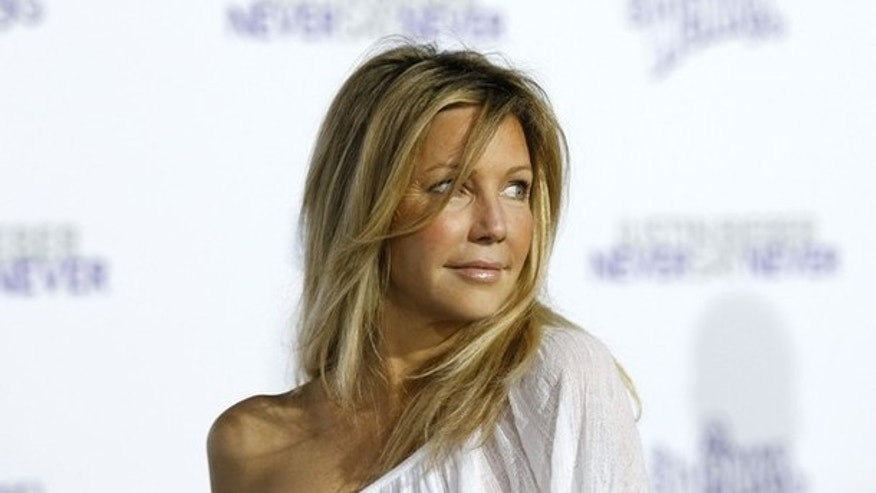 "Actress Heather Locklear poses at the premiere of the documentary ""Justin Bieber: Never Say Never"" at Nokia theatre in Los Angeles February 8, 2011."