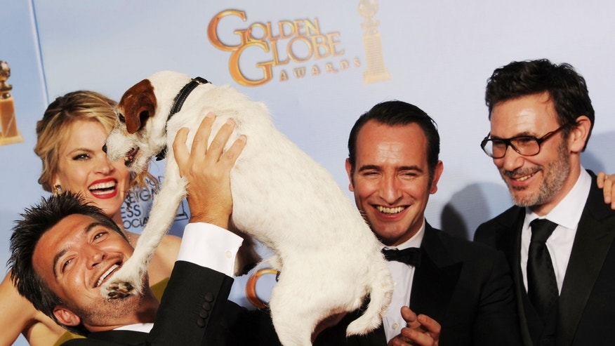 "BEVERLY HILLS, CA - JANUARY 15:  (L-R)  Producer Thomas Langmann, actress Missi Pyle, Uggie the Dog, actor Jean Dujardin, and director Michel Hazanaviciu pose in the press room with the Best Motion Picture - Musical or Comedy award for ""The Artist"" at the 69th Annual Golden Globe Awards held at the Beverly Hilton Hotel on January 15, 2012 in Beverly Hills, California.  (Photo by Kevin Winter/Getty Images)"