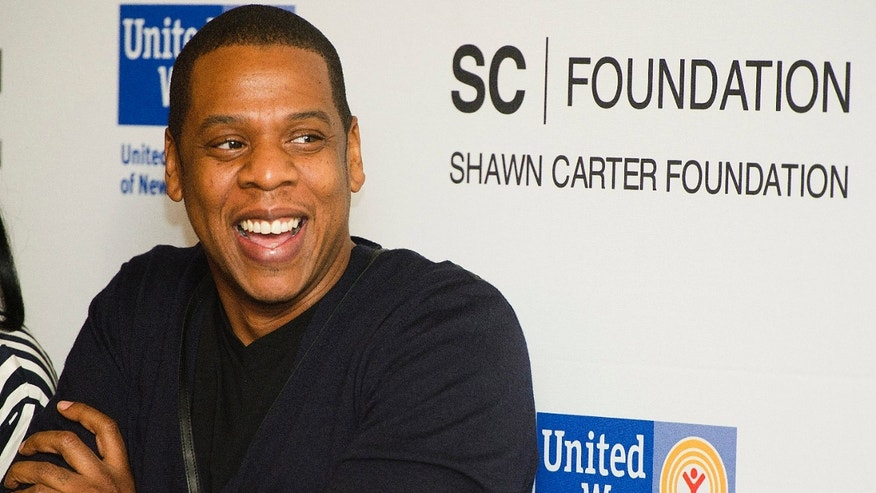 "Shawn ""Jay Z"" Carter attends a press event to announce his Carnegie Hall performances to benefit the United Way and the Shawn Carter Scholarship Foundation, in New York, Thursday, Dec. 8, 2011. (AP Photo/Charles Sykes)"