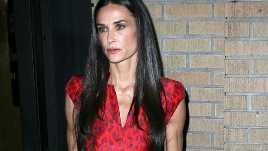 Demi Moore attends the 'Margin Call' premiere at the Landmark Sunshine Cinema on October 17, 2011 in New York City looking vacant, wearing her wedding ring and very thin. October 17, 2011. X17online.com