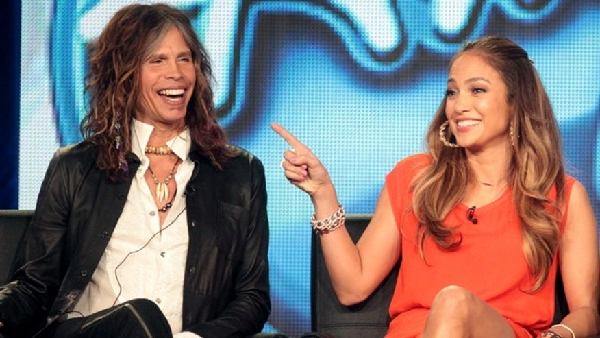 "Jan. 8, 2012: Judges Steven Tyler and Jennifer Lopez speak onstage during the ""American Idol"" panel during the FOX Broadcasting Company portion of the 2012 Winter TCA Tour at The Langham Huntington Hotel and Spa in Pasadena, Calif."