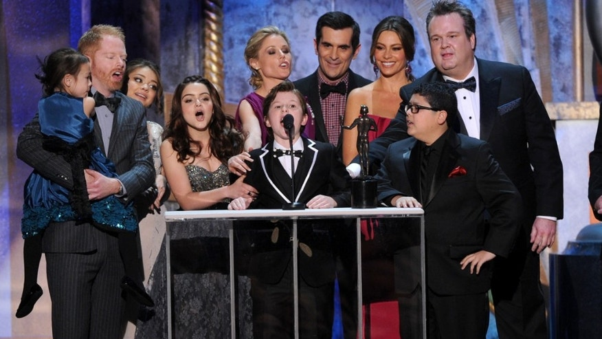LOS ANGELES, CA - JANUARY 29:  The cast of 'Modern Family' accept the Outstanding Performance by an Ensemble in a Comedy Series award for 'Modern Family' onstage during the 18th Annual Screen Actors Guild Awards at The Shrine Auditorium on January 29, 2012 in Los Angeles, California.  (Photo by Kevin Winter/Getty Images)