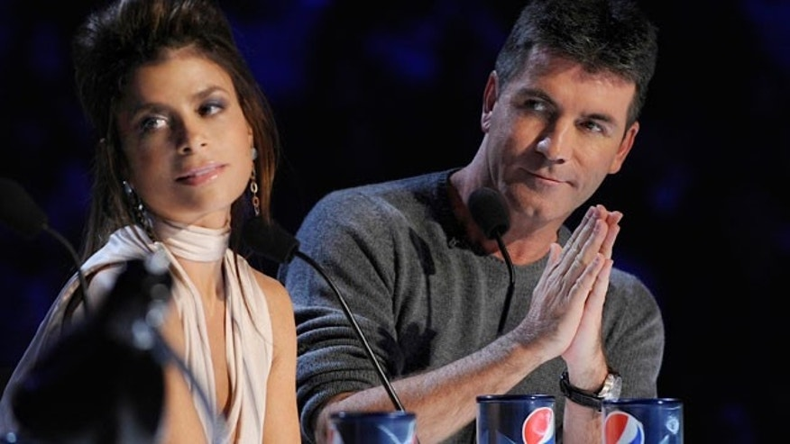 Paula Abdul and Simon Cowell (AP)