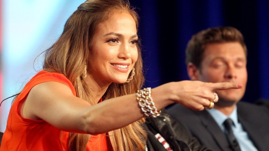 PASADENA, CA - JANUARY 08:  Judge Jennifer Lopez speaks onstage during the 'American Idol' panel during the FOX Broadcasting Company portion of the 2012 Winter TCA Tour at The Langham Huntington Hotel and Spa on January 8, 2012 in Pasadena, California.  (Photo by Frederick M. Brown/Getty Images)