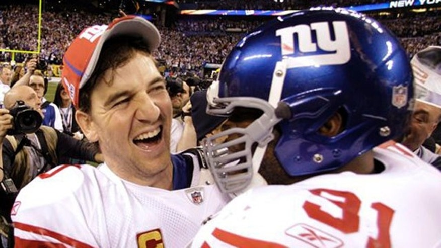 Feb. 5, 2012: New York Giants quarterback Eli Manning, left, and Justin Tuck celebrate their team's 21-17 win over the New England Patriots in the NFL Super Bowl XLVI football game in Indianapolis.