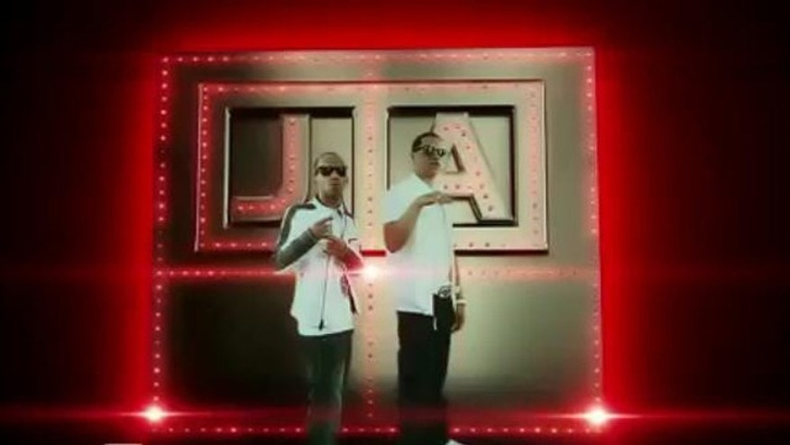 "J. Alvarez and Arcangel in their music video ""Regalame una noche"""