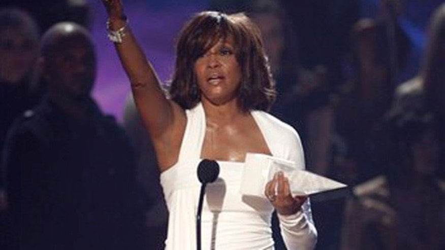 Nov. 22, 2009: In this file photo, Artist Whitney Houston receives the International Artist Award onstage at the 37th Annual American Music Awards in Los Angeles.