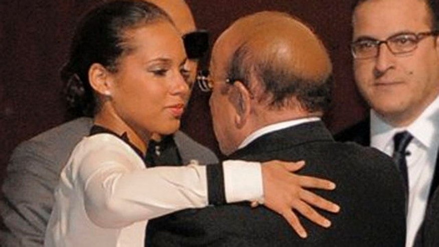 Feb. 12, 2012: Alicia Keys, left, hugs Clive Davis at the loading dock outside the Beverly Hilton Hotel.