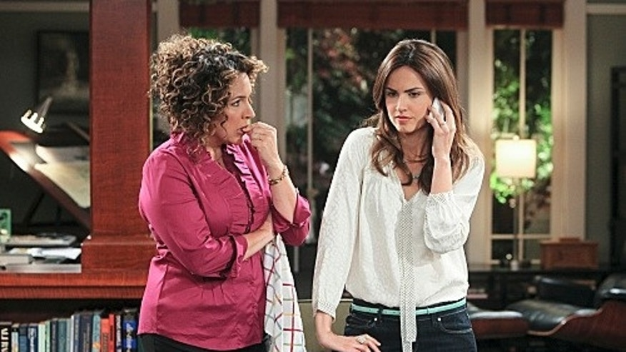 """Rob Learns Spanish""-- Rosa (Diana Maria Riva) and Maggie (Claudia Bassols) try to figure out what Rob is hiding on ""Rob,"" Thursday, February 9 (8:31 – 9:00 PM, ET/PT) on the CBS Television Network.Photo: Monty Brinton/CBS ©2011 CBS Broadcasting Inc. All Rights Reserved."