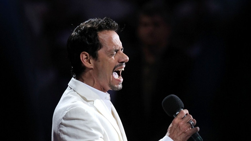 MIAMI, FL - JUNE 12:  Singer Marc Anthony performs the National Anthem at Game Six of the 2011 NBA Finals between the Miami Heat and the Dallas Mavericks at American Airlines Arena on June 12, 2011 in Miami, Florida. NOTE TO USER: User expressly acknowledges and agrees that, by downloading and/or using this Photograph, user is consenting to the terms and conditions of the Getty Images License Agreement.  (Photo by Ronald Martinez/Getty Images)