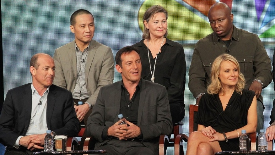 "Jan. 06, 2012:  (Front Row) Executive Producer Howard Gordon, Actor Jason Isaacs, Actress Laura Allen, Executive Producer Kyle Killen, (Back Row) Actor BD Wong, Actress Cherry Jones, Actor Steve Harris and Actor Wilmer Valderrama speak onstage during the ""Awake"" panel during the NBC Universal portion of the 2012 Winter TCA Tour at The Langham Huntington Hotel and Spa in Pasadena, Calif."