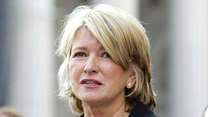 Martha Stewart reads a statement after sentencing at Manhattan federal court, Friday July 16, 2004, in New York. Stewart was sentenced Friday to five months in prison and five months of home confinement for lying about a stock sale.  At right is her attorney Robert G. Morvillo. (AP Photo/Bebeto Matthews)