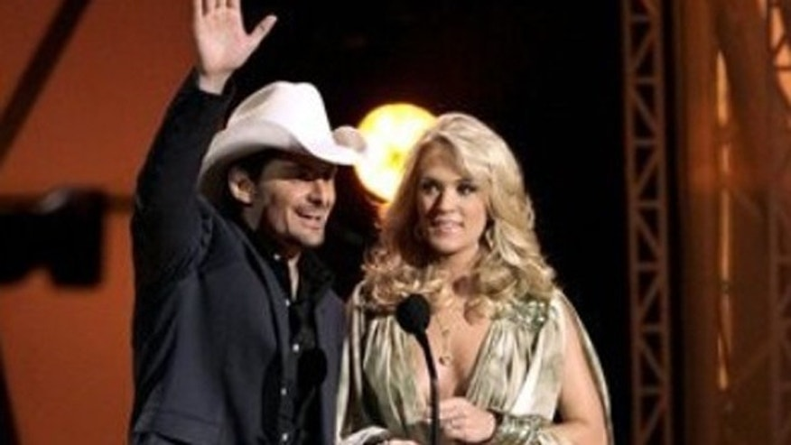 Nov. 9, 2011: Hosts Brad Paisley, left, and Carrie Underwood speak during the 45th Annual CMA Awards in Nashville, Tenn.