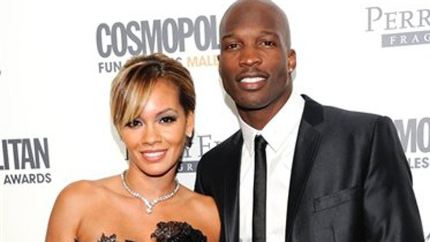 "FILE - In this March 7, 2012 file photo, NFL Football player Chad Ochocinco, right, poses with his fiancee ""Basketball Wives"" star Evelyn Lozada at the Cosmopolitan Magazine's 'Fun Fearless Males of 2011' event in New York. VH1 said Monday, March 12,  that its eight-part series ""Ev and Ocho"" chronicling their sports-related celebrity wedding will air in September.  Lozada has been featured in four seasons of ""Basketball Wives,"" beginning with the end of her engagement to basketball player Antoine Walker. Ochocinco is a wide receiver for the New England Patriots. (AP Photo/Evan Agostini, file)"