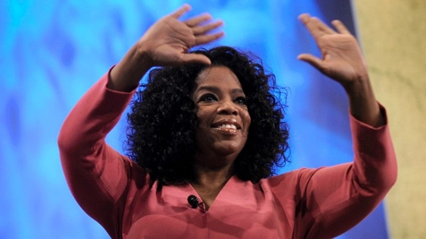 June 16: Oprah Winfrey greets the crowd before talking with Paula Zahn during the National Cable & Telecommunications Association's Cable Show 2011 at McCormick Place in Chicago.