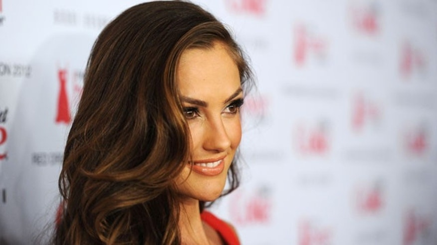 Feb. 8, 2012:  Actress Minka Kelly attends the Heart Truth's Red Dress Collection 2012 Fashion Show at Hammerstein Ballroom in New York City.
