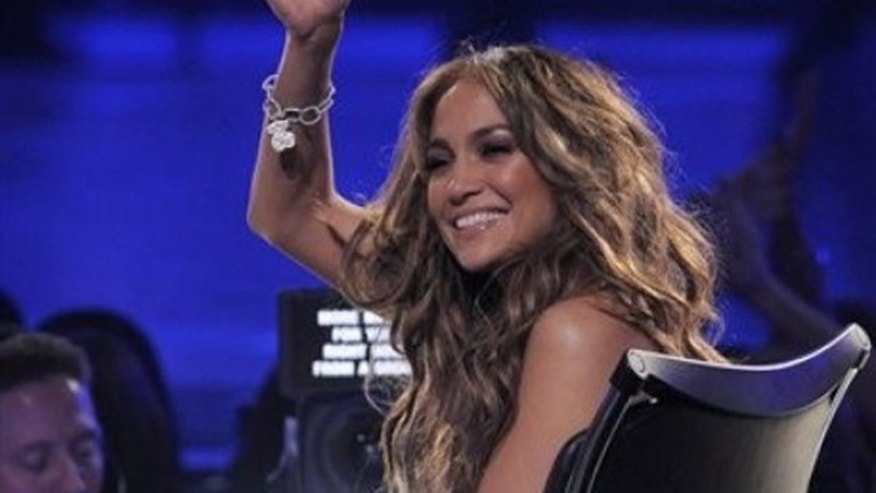 """Judge Jennifer Lopez is seen at the """"American Idol"""" finale on Wednesday, May 25, 2011, in Los Angeles. (AP Photo/Chris Pizzello)"""