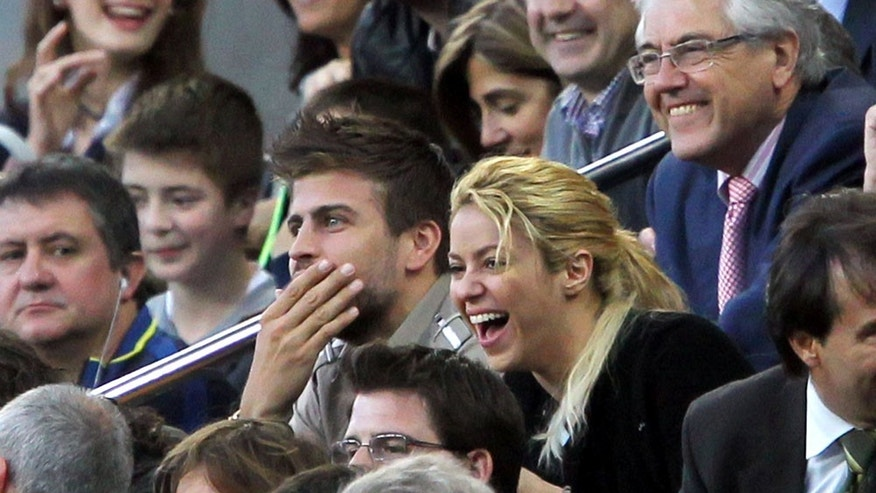 Photos © 2011 The Grosby Group -Spain, Apr 20, 2011Colombian singer Shakira kisses Barcelona player Gerard Pique during the la Liga match between Barcelona and Osasuna (2-0) at the Camp Nou stadium.TGT *** Local Caption *** .