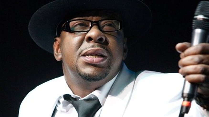 In this Feb. 18, 2012 file photo, singer Bobby Brown, former husband of the late Whitney Houston performs with New Edition at Mohegan Sun Casino in Uncasville, Conn.
