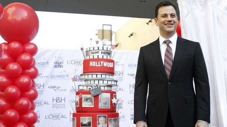 Feb. 1, 2012: Television host Jimmy Kimmel poses next to a cake during a celebration for the 125th anniversary of the City of Hollywood in Hollywood, California.
