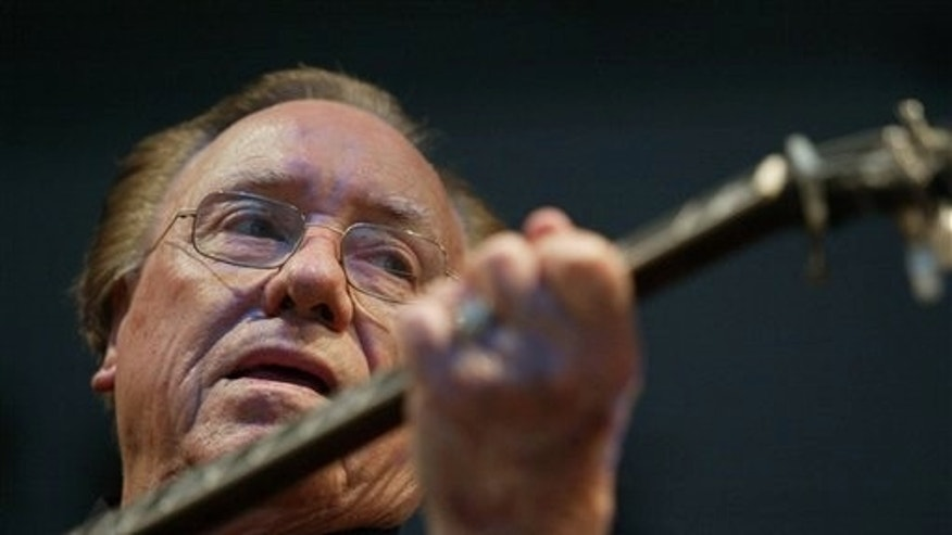 In this June 10, 2005 file photo, Earl Scruggs, performs at the Bonnaroo Music & Arts Festival in Manchester, Tenn.