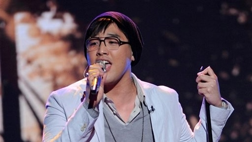 "In this March 28, 2012 photo released by Fox, contestant Heejun Han performs on the singing competition series ""American Idol,"" in Los Angeles.  Han, the 22-year-old nonprofit organizer from New York, was voted off the program on Thursday, March 29."