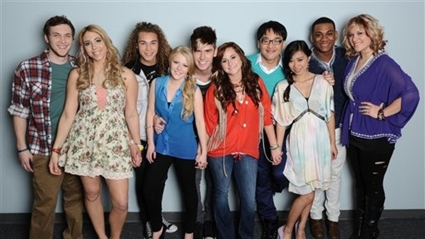 In this undated image released by Fox, the remaining ten contestants from the singing competition series, from left,  Phillip Phillips, Elise Testone, DeAndre Brackensick, Hollie Cavanaugh, Colton Dixon, Skylar Laine, Heejun Han, Jessica Sanchez, Josh Ledet and Erika Van Pelt, pose for a group photo in Los Angeles.