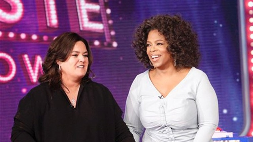 "Oct. 10, 2011: In this file image released by Harpo, Inc., Oprah Winfrey, right, is shown with host Rosie O'Donnell during the debut of ""The Rosie Show"" in Chicago."