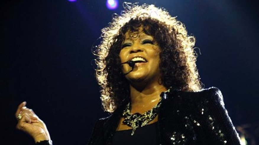 April 25, 2010: In this file photo, singer Whitney Houston performs at the o2 in London as part of her European tour.
