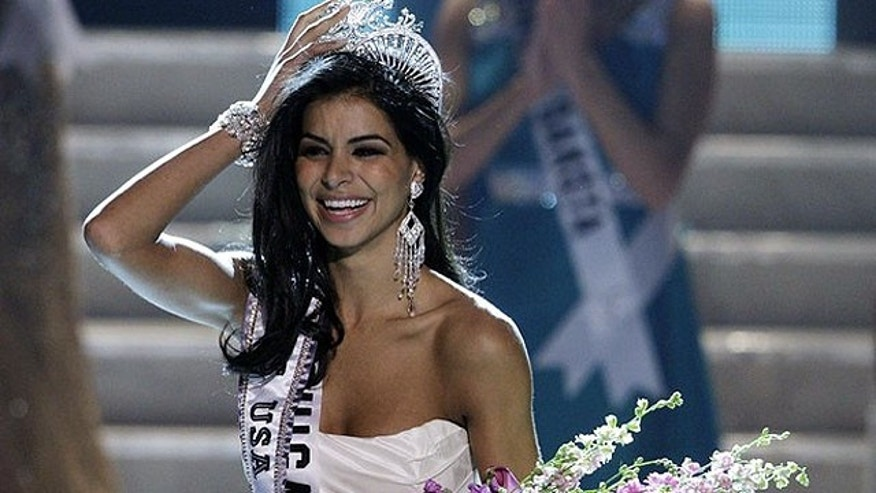 Miss Michigan Rima Fakih reacts after being crowned Miss USA during the 2010 Miss USA pageant at the Planet Hollywood Resort and Casino in Las Vegas, Nevada May 16, 2010. REUTERS/Steve Marcus (UNITED STATES - Tags: SOCIETY) FOR EDITORIAL USE ONLY. NOT FOR SALE FOR MARKETING OR ADVERTISING CAMPAIGNS