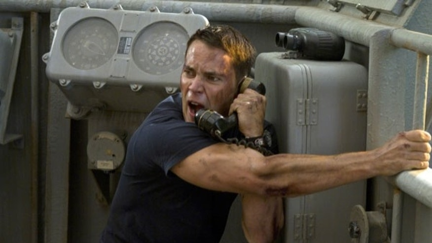 "In this film image released by Universal Pictures, Taylor Kitsch is shown in a scene from ""Battleship."""