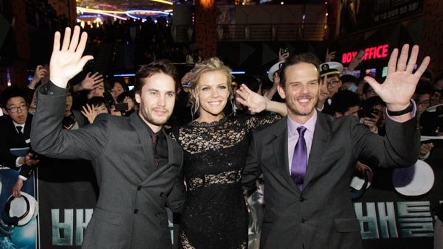 "April 5: Director Peter Berg, right, poses with actress Brooklyn Decker, center, and actor Taylor Kitsch during the premiere of their movie ""Battleship"" in Seoul, South Korea."