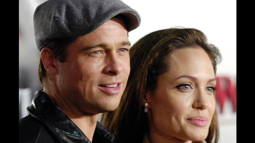 "Angelina Jolie, right, a cast member in ""Beowulf,"" poses with Brad Pitt at the premiere of the film in Los Angeles, Monday, Nov. 5, 2007. (AP Photo/Chris Pizzello)"