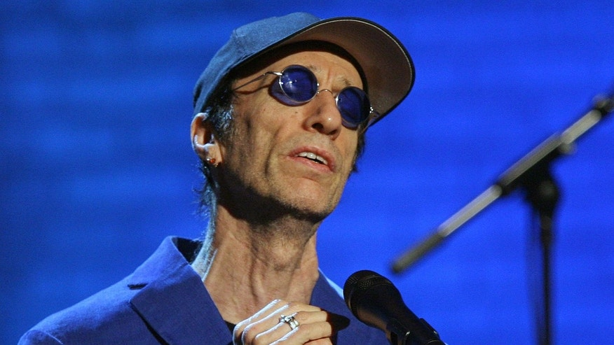 "Dec. 14, 2006: Robin Gibb performs during the ""Jose Carreras Gala"" rehearsal in Leipzig, eastern Germany.  The Sun newspaper reported Saturday April 15, 2012 that 62-year-old Gibb is in a coma, citing a family friend."
