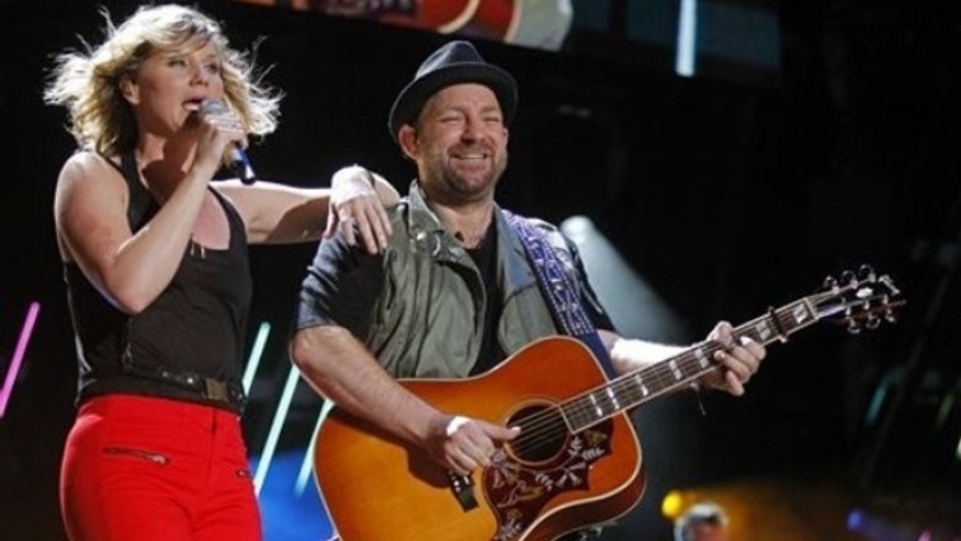Jennifer Nettles, left, and Christian Bush of Sugarland perform during the CMA Fan Festival Friday, June 10, 2011 in Nashville, Tenn. (AP Photo/Wade Payne)