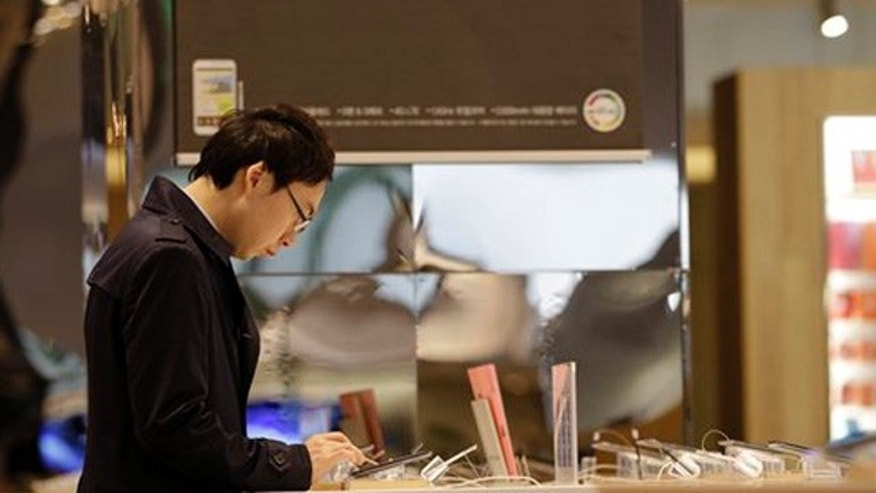 April 6, 2012: A visitor operates a Galaxy tablet of Samsung Electronics at a showroom of its headquarters in Seoul, South Korea.