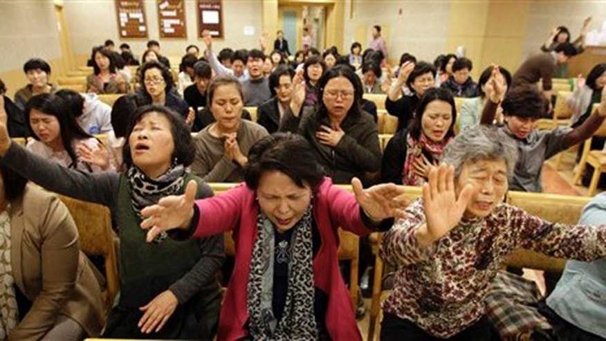 April 22, 2012: South Korean Christians pray during a service as they call for the cancellation of a concert of U.S. pop star Lady Gaga at a church in Seoul, South Korea.