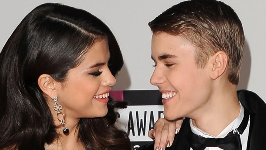LOS ANGELES, CA - NOVEMBER 20:  Actress Selena Gomez and musician Justin Bieber arrive at the 2011 American Music Awards held at Nokia Theatre L.A. LIVE on November 20, 2011 in Los Angeles, California.  (Photo by Jason Merritt/Getty Images)