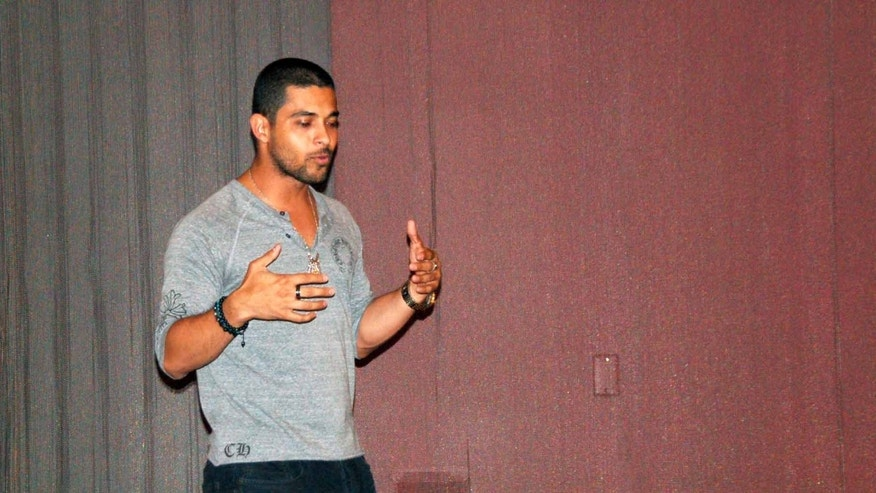 Actor Wilmer Valderrama speaks to a crowded room at Arizona State University at an event sponsored by the 'Voto Latino' campaign, an effort aimed at increasing the presence of young Latino voters in the next election.