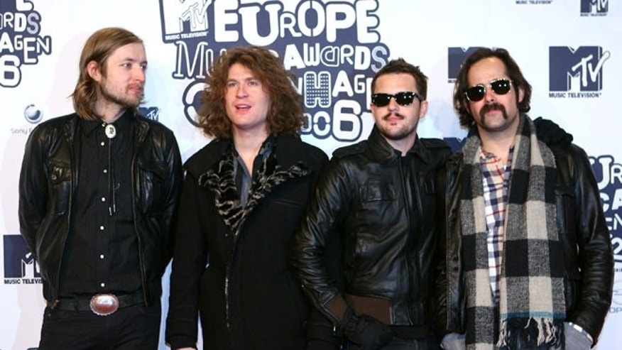 A saxophonist for the Killers (not shown) has been found dead. From L to R, Killers band members Mark Stoermer, David Keuning, Brandon Flowers and Ronnie Vannucci at the 13th Annual MTV Europe Music Awards 2006.