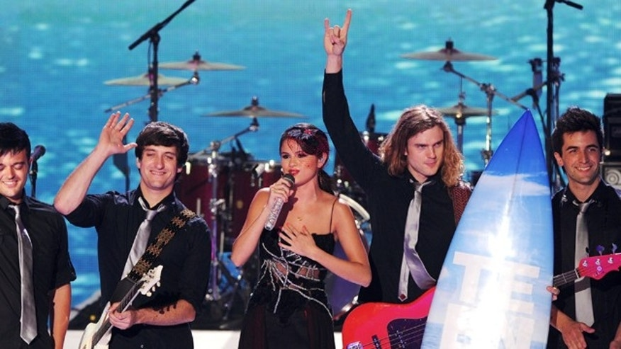 "Aug. 7, 2011: Singer Selena Gomez and her band ""The Scene"" perform onstage during the 2011 Teen Choice Awards held at the Gibson Amphitheater in Universal City, Calif."