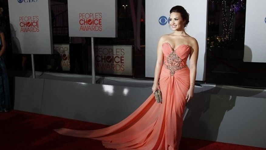 Actress and singer Demi Lovato arrives at the 2012 People's Choice Awards in Los Angeles January 11, 2012. REUTERS/Danny Moloshok (UNITED STATES - Tags: ENTERTAINMENT)