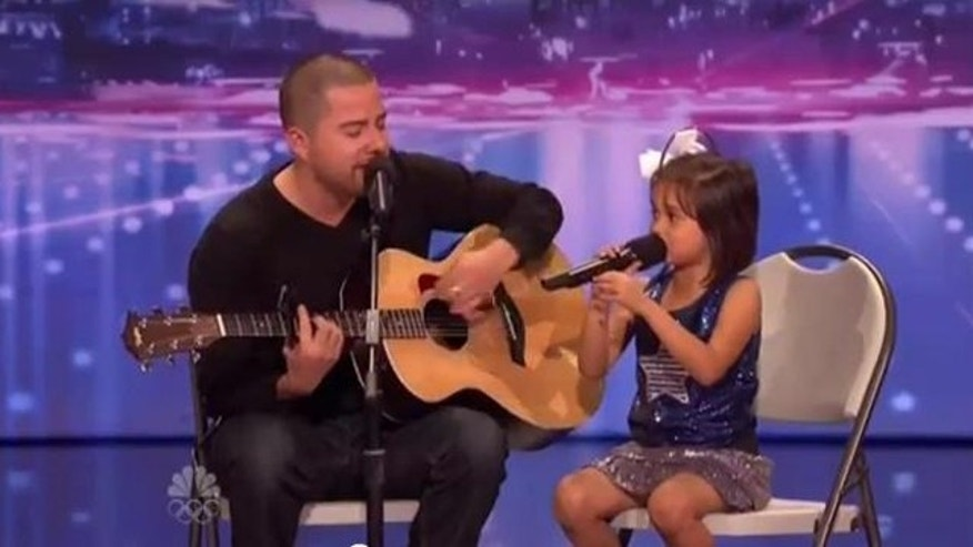 "May 14, 2012: Jorge and Alexa Narvaez sing Edward Sharpe & The Magnetic Zeros' ""Home"" Monday night on ""America's Got Talent."""
