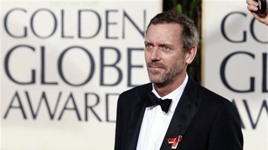 Hugh Laurie arrives at the 67th Annual Golden Globe Awards on Sunday, Jan. 17, 2010, in Beverly Hills, Calif. (AP Photo/Matt Sayles)
